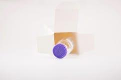 Acción del frasco de la caja del envase Imagen de archivo libre de regalías