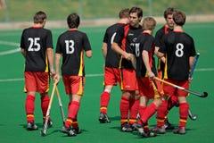 Acción del hockey de campo del Mens Fotografía de archivo