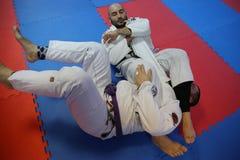 Acción del judo - técnica de la presentación Imágenes de archivo libres de regalías
