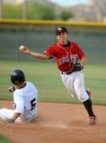 Acción del juego de béisbol de la High School secundaria Imagen de archivo