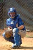 Acción del juego de béisbol de la liga pequeña Fotografía de archivo