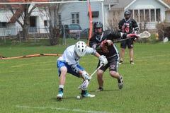 Acción del lacrosse Fotografía de archivo libre de regalías