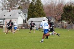 Acción del lacrosse Fotografía de archivo