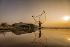 Acción del pescador Foto de archivo libre de regalías