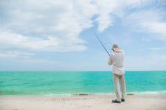 Acción del pescador al pescar Foto de archivo