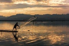 Acción del pescador de la opinión de la belleza Imagen de archivo
