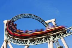 Acción del roller coaster Imagen de archivo libre de regalías