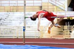 Acción del salto de altura (enmascarada) Imagenes de archivo