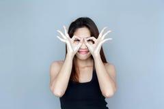 acción divertida de la señora asiática Imagenes de archivo