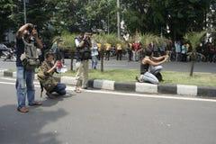 Acción extranjera de los periodistas y de los fotógrafos Foto de archivo