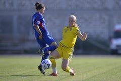 Acción femenina del partido de fútbol Imágenes de archivo libres de regalías