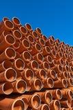 Acción industrial anaranjada del pvc de los tubos Fotos de archivo