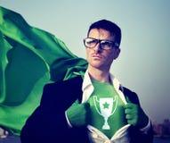 Acción profesional C de la capacitación del éxito fuerte del super héroe del trofeo Foto de archivo libre de regalías