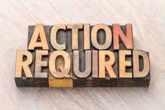 Acción requerida - bandera en el tipo de madera Fotografía de archivo libre de regalías