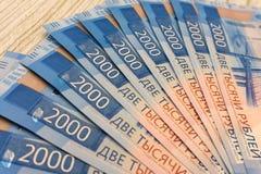 Acción rusa de la muestra de los ahorros del sueldo del fondo de los billetes de banco Imagen de archivo