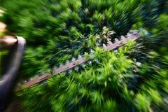 Acción tirada de arbusto del corte del condensador de ajuste de seto Foto de archivo