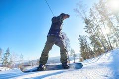 Acción tirada de Snowboarder Fotografía de archivo libre de regalías