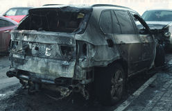 Accident or arson burnt car on road Royalty Free Stock Photos