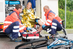 Accident bike woman get emergency help paramedics. Accident bike women get emergency help paramedics in ambulance stock photos