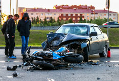 Accident with the cyan bike and car. NOVYY URENGOY, RUSSIA - JULY 10, 2017: Accident with the cyan bike and car Lada 110 in the city street stock image