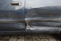 Accident damage. On the left side by the car Stock Photography