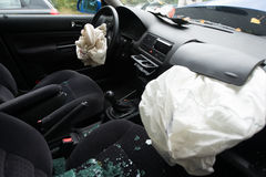 Accident damaged car with opened airbag. A car damaged in an accident with opened airbag Royalty Free Stock Photography
