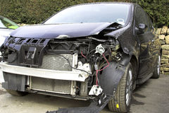 Accident Damaged Vehicle. An accident damaged vehicle with front end damage royalty free stock image