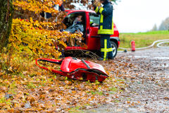Accident - Fire brigade rescues Victim of a car. Accident - Fire brigade rescues accident Victim of a car, a car door lying on the slippery pavement Stock Photos