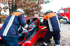 Accident - Fire brigade rescues Victim of a car Royalty Free Stock Photos