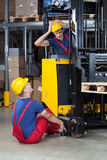 Accident on a forklift. Vertical view of an accident on a forklift royalty free stock photos