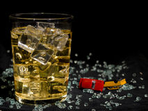 Accident. Glass of whisky and several toy cars Stock Photo