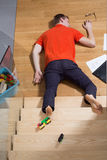 Accident at home. Man falling down from the stairs Stock Photo