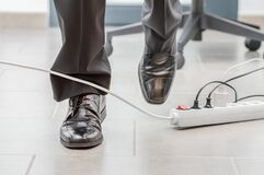 Free Accident In The Office With The Cable Royalty Free Stock Image - 217539756