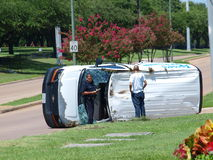Accident Investigation. Dallas,USA,13 July 2017. A van-type service truck lay on its side at the front gate of a funeral home and cemetery. The car is to the Royalty Free Stock Photos