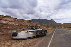 Accident involving a boat overturned on a highway Royalty Free Stock Image