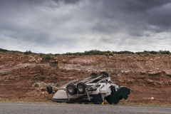 Accident involving a boat overturned on a highway Stock Images
