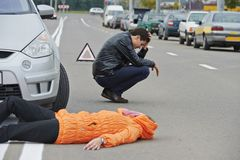 Accident. knocked down pedestrian. Road accident. Knock down pedestrian and upset driver in front of automobile crash car collision Royalty Free Stock Photos