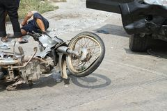 Accident motorcycle with a car Royalty Free Stock Photography