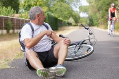 Accident older man cycling Stock Photos