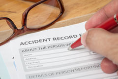 Accident report application form and human hand with pen Stock Photography