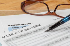 Accident report application form and pen on brown envelope and e Royalty Free Stock Photos