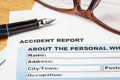 Accident report application form and pen on brown envelope and e Stock Photos