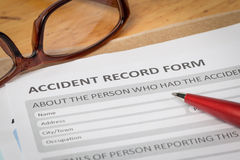 Accident report application form and pen on brown envelope and e Royalty Free Stock Photo