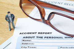 Accident report application form and pen on brown envelope Stock Image
