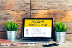 Accident report form by internet. Stock Photos