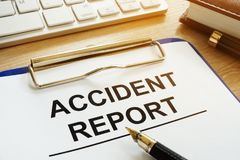 Accident report and pen. Accident report and pen on a desk stock photo
