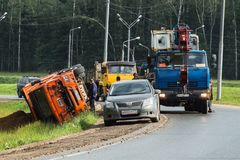 A boom crane arrived for lifting an overturned lorry, Moscow suburbs, Russia. Stock Image