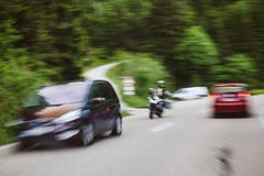Accident situation with motorcycle and two cars. On highway surrounded by tree forest Stock Photography