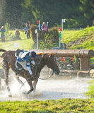 Accident at the water jump. Stock Photos