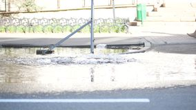 Accident water supply system water flows over the road from manhole. Close up stock video